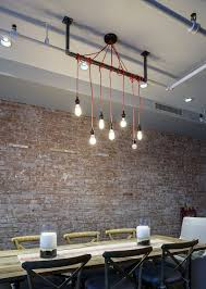 dazzling feast 21 creatively fun ways to light up the dining room simplicity of the lighting makes a bold statement in the industrial dining room design