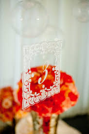 wedding reception centerpieces with lace adorned table numbers
