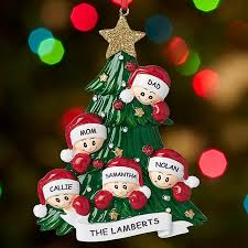 family around tree ornament tree ornament and