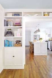 How To Make Bookcases Look Built In Adding Built In Bookshelves Around Our Living Room Doorway Young