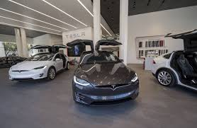 tesla motors plans to charge for its quick charge access wsj
