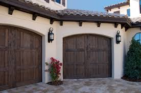 Costco Garage Doors Prices by Outdoor Wall Sconces With Decorative Flower Also Rustic Wood