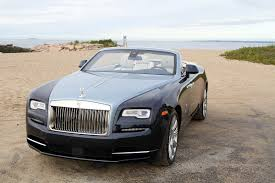 roll royce rolsroy dawn patrol cruising with the rolex deepsea in the new rolls royce