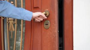 Front Door House Inserting A Key Into A House Front Door Stock Video Footage