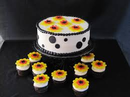 black yellow and white bridal shower cake with cupcakes the