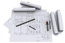 compass ruler and pencil on architectural drawings stock photo