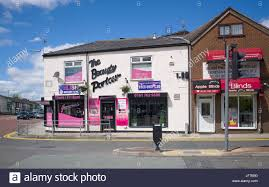 beauty parlour and window blinds shop at junction of rochdale road