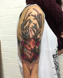 neotraditional deer tattoo on the right upper arm and shoulder