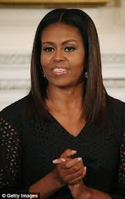 michelle obama pictured wearing her natural hair daily mail online