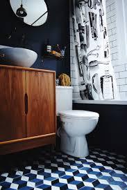 black and blue bathroom ideas brass bath fittings encaustic patterned cement tiles hague blue