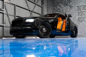 roll royce forgiato murdered out rolls royce wraith keeps the party on the inside