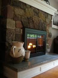 handmade concrete hearth and custom mantel by northeast furniture