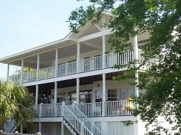 house with wrap around porch lovely family home one house from the homeaway tybee island
