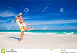 Tropical Clothes For Travel Couple In Bright Clothes Having Fun At Tropical Stock Photo