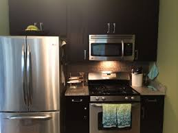 Stained Kitchen Cabinets by Painting Stained Kitchen Cabinets On 600x400 Painting Vs