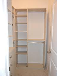 small reach in closet with door panels dark toned wooden floors of