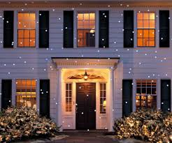 solar christmas light projector led snow flurry projection light clark griswold green box and