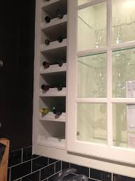 wine rack built in next to kitchen cabinets c o ikea kitchen