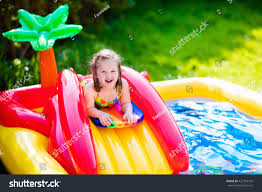 children playing inflatable baby pool kids stock photo 422793169