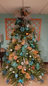 best 25 orange christmas tree ideas on pinterest orange teal and orange christmas tree for my morroccan inspired basement