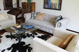 Linen Chesterfield Sofa by Linen Chesterfield Sofa Glass Cocktail Table And Cowhide Rug