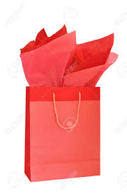 present tissue paper christmas gift bag with tissue paper isolated on white
