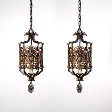 antique bronze pendant light two matching antique spanish revival figural bronze pendant lights