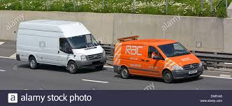mercedes towing mercedes rac towing white ford on motorway stock