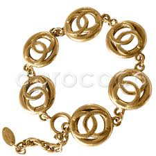 gold plated bracelet charms images Aprococo vintage chanel gold plated bracelet with cut out cc jpg