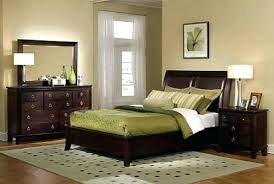 black and silver bed frame and silver bed green and blue bedroom