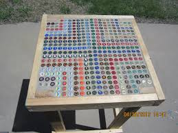beer cap table top confessions of three former 4 hers bottle cap bbq table