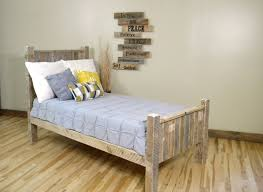 reclaimed wooden twin size panel bed and nice wall decor bedroom