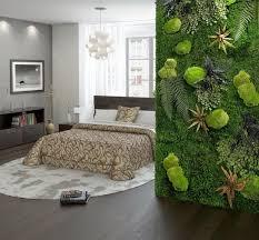 suspension design chambre chambre moderne avec sol en parquet foncé mur végétal peinture