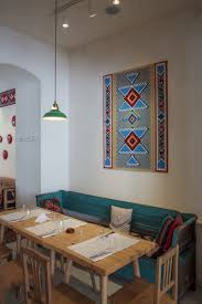 decorating beautiful restaurant design ideas with artistic scheme decorating tribal wall mural lacrimi si sfinti tosca long bench wood table beautiful restaurant