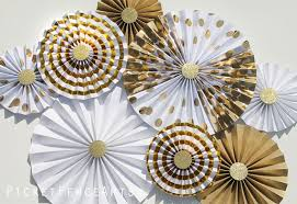 white paper fans white and gold paper rosettes paper fans backdrop wedding