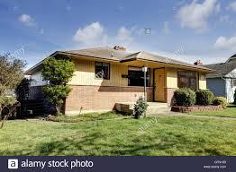 Rambler Home Yellow Brick American Rambler Exterior With Front Wood Door Stock