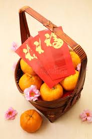 new years basket mandarin oranges in basket with new year packets stock