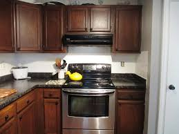 refinish oak kitchen cabinets staining oak cabinets dark cherry centerfordemocracy org