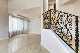 emtpy house interior with shiny tile floor and brith white walls