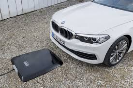 electric cars bmw bmw is set to offer a pad to wirelessly charge your car the verge