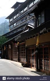 traditional shop fronts in modern japanese street scene miyajima
