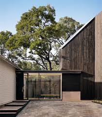 Front To Back Split House Alterstudio Adds Dark Stained Extension To White Bungalow In Texas