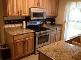 Kitchen With Light Oak Cabinets Honey Oak Cabinets With Black Granite Countertops Google Search
