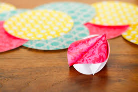 what to write on a paper fortune teller how to make origami paper fortune cookies unsophisticook how to make paper fortune cookies pinned over 110 000 times these cute diy