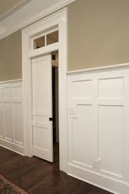 Cottage Wainscoting Craftmaster Doors For A Traditional Living Room With A Brick