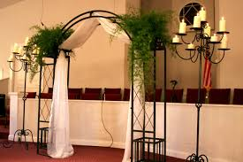 wedding arch no flowers this idea for hett i would do just the arch and candelabras
