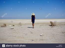woman walking on the beach at the salton sea california stock