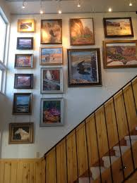curtain tracks to display artwork above staircase hanging