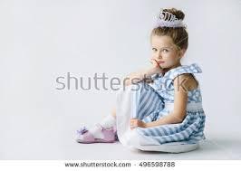 funny kid blue white dress jumping stock photo 496598797