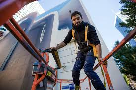 see the new greenway mural spaces of hope take shape in photos mehdi ghadyanloo climbs into a cherry picker to begin painting a mural on the wall in